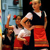 "Sarina Nikolova, right, leads a group of children out to perform Bulgarian dances.<br /> The University of Colorado hosted the 20th Annual International Festival on Saturday that featured traditions, customs and food  from around the world.<br /> For more photos and a video, go to  <a href=""http://www.dailycamera.com"">http://www.dailycamera.com</a>.<br /> Cliff Grassmick / April 24, 2010"