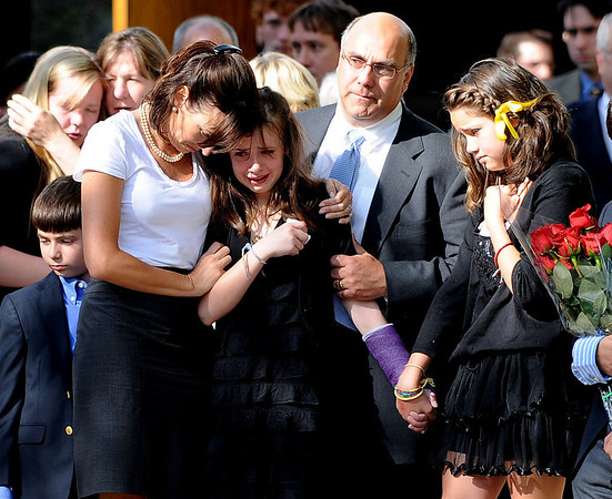 "Avery Griffin, center, 13, the daughter of Sean and Staci Griffin, is comforted by friends and family after the memorial service for her parents.<br /> For a video, go to  <a href=""http://www.dailycamera.com"">http://www.dailycamera.com</a>.<br /> Cliff Grassmick / May 21, 2010"