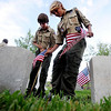 Members of Boy Scout Troop 77 of Boulder planted flags at the graves of war veterans on Wednesday at Green Mountain Cemetery.<br /> Cliff Grassmick / May 26, 2010