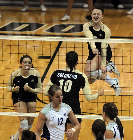 "Elysse Richardson, left, and Hannah Walker, both of CU,  get excited after a point against Kansas State.<br /> For more photos from the game, go to  <a href=""http://www.dailycamera.com"">http://www.dailycamera.com</a>.<br />  Cliff Grassmick / September 22, 2010"