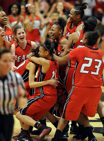 The Denver East Angels win over Legacy after a high school basketball in the Colorado 5A State Championship on Friday, March, 12, 2010, in Boulder, Colo. (AP Photo/The Daily Camera, Cliff Grassmick) ** LONGMONT TIMES-CALL OUT, EXAMINER OUT **