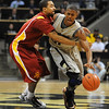 "Cory Higgins of CU gets fouled by Diante Garrett of ISU.<br /> For more  photos of the game, go to  <a href=""http://www.dailycamera.com"">http://www.dailycamera.com</a>.<br /> Cliff Grassmick / February 27, 2010"