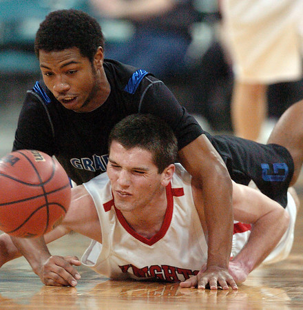 "Darragh O'Neill, bottom, of Fairview, and Dominique Lawrence of Grandview, go to the floor for a loose ball on Friday.<br /> For more Fairview photos, go to photo galleries at  <a href=""http://www.dailycamera.com"">http://www.dailycamera.com</a>.<br /> Cliff Grassmick / March 5, 2010"