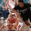"Darragh O'Neill, left, of Fairview, and Dominique Lawrence of Grandview, go to the floor for a loose ball on Friday.<br /> For more Fairview photos, go to photo galleries at  <a href=""http://www.dailycamera.com"">http://www.dailycamera.com</a>.<br /> Cliff Grassmick / March 5, 2010"