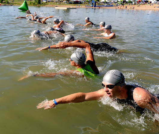 "Steven Hackett, bottom, and the professional men begin the Boulder Peak Triathlon in Boulder Reservoir on Sunday. Tim O'Donnell was the eventual winner.<br /> For more photos  and video of the Boulder Peak, go to  <a href=""http://www.dailycamera.com"">http://www.dailycamera.com</a><br />  Cliff Grassmick / July 11, 2010"
