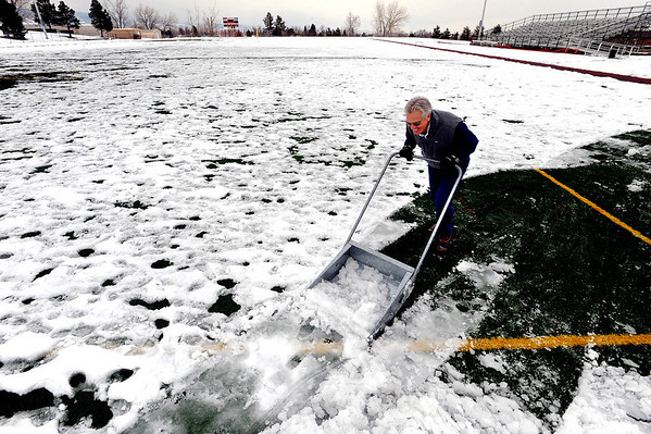 Keith Timm takes on the big job of removing the snow from the Fairview High School soccer field on Thursday. He took it upon himself to volunteer for the job since soccer try outs  and a tournament are coming up at the school this weekend.<br /> Cliff Grassmick / February 25, 2010