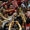 Denver East fans get to touch the 5A Girls  Colorado State Championship trophy after the win over Legacy on March 12, 2010 at the Coors Events Center in Boulder.<br /> <br /> Cliff Grassmick / March 12, 2010