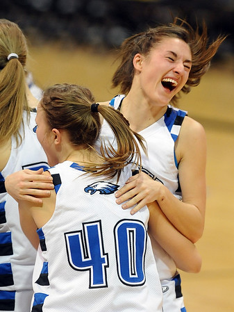 Brittany Zec of Broomfield jumps in the arms of Taylor Schreter after the Eagles won their fourth 4A State Championship on Friday, March 12, 2010 in Boulder. (AP Photo/The Daily Camera, Cliff Grassmick) ** LONGMONT TIMES-CALL OUT, EXAMINER OUT **