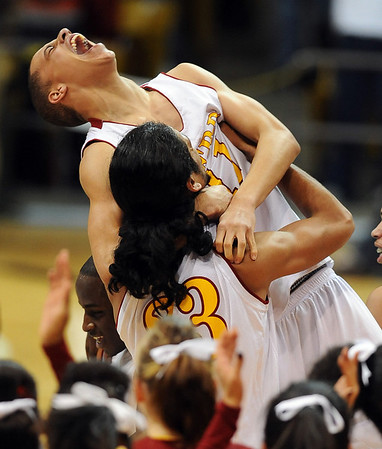 Lorrell Livingston of Sierra  High School is lifted up by teammate Chris Fielder after his team won the 4A Colorado State Championship on March 13, 2010 in Boulder.<br /> <br /> Cliff Grassmick / March 13, 2010