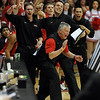Fairview coach Frank Lee and the bench react to a Knight hussle play in the first half of the game against Regis Jesuit.<br /> <br /> Cliff Grassmick / March 13, 2010