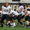B.J. Beaty (59) leads the CU White team in a Maori warrior chant before the CU Spring on Saturday.<br /> Cliff Grassmick / April 10, 2010