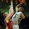 "Cory Higgins of CU slams one over Scott Christopherson of Iowa State on Saturday.<br /> For more  photos of the game, go to  <a href=""http://www.dailycamera.com"">http://www.dailycamera.com</a>.<br /> Cliff Grassmick / February 27, 2010"