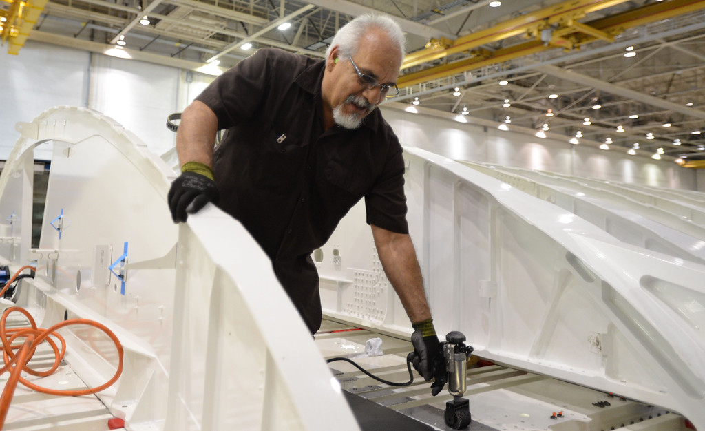 . Long Beach, Calif., -- 08-13-13-   Aerospace worker Carlos Arriaga works on a new Boeing C-17 Globemaster III as it\'s assembled at the C-17 plant in Long Beach Calif.    Stephen Carr/  Los Angeles Newspaper Group