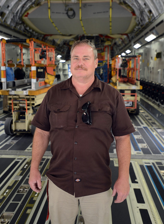 . Long Beach, Calif., -- 08-13-13-   Field service mechanic Richard Crandell  on a new Boeing C-17 Globemaster III as it\'s assembled at the C-17 plant in Long Beach Calif. Crandell has been working for Boeing for 34 years.    Stephen Carr/  Los Angeles Newspaper Group