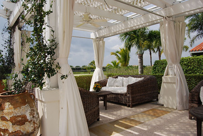 Outdoor lounge area of the International Polo Club Palm Beach. We designed a few of these extra deep sofas hand made in Brasil from cipo vines.
