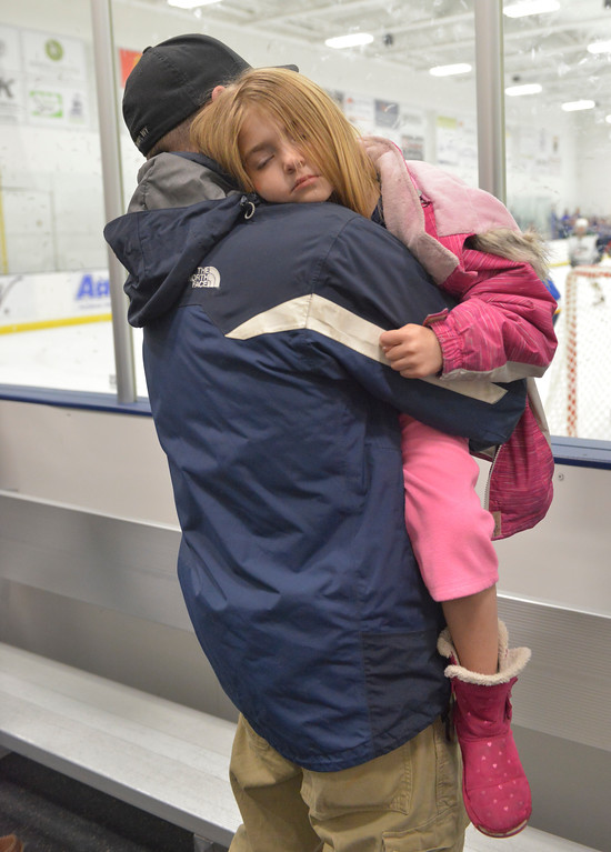 Justin Sheely | The Sheridan Press<br /> <br /> Josh Lavigne holds his tired daughter Lily Lavigne, 5, during the Hawks game against Pinedale at Whitney Ice in the M&M's Center Saturday, Jan. 20, 2018.