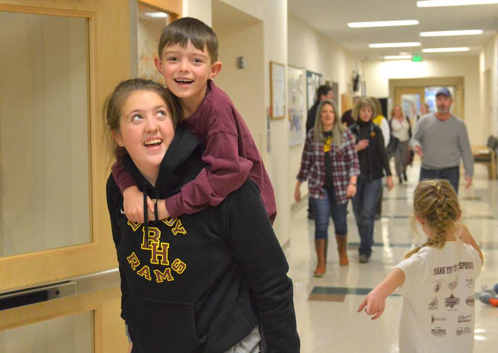 Justin Sheely | The Sheridan Press<br /> <br /> Big Horn High School freshman Amelia Gee carries James DeHaven, first grade, during halftime of the Eagle's game against Big Horn at Tongue River High School Saturday, Jan. 20, 2018.