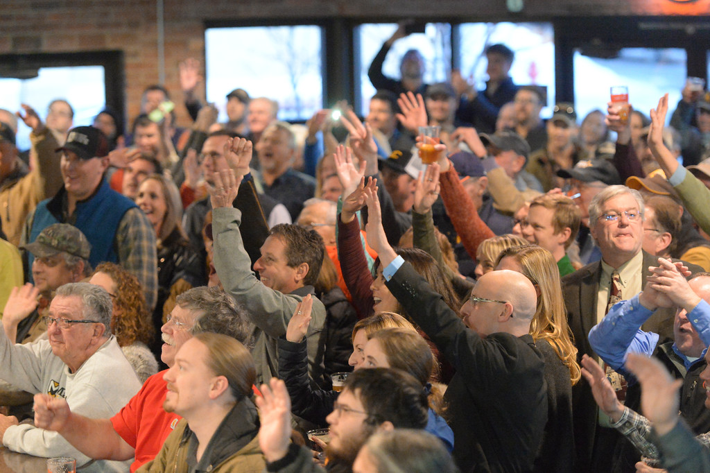 Justin Sheely | The Sheridan Press<br /> <br /> People react to the announcement of Weatherby moving to Sheridan during the Project Enterprise announcement at Black Tooth Brewing Company Tuesday, Jan. 23, 2018. Adam Weatherby announced via Facebook Live plans to move his family's well-known firearms manufacturer to Sheridan, adding an additional 65-90 jobs to the community over the next several years.