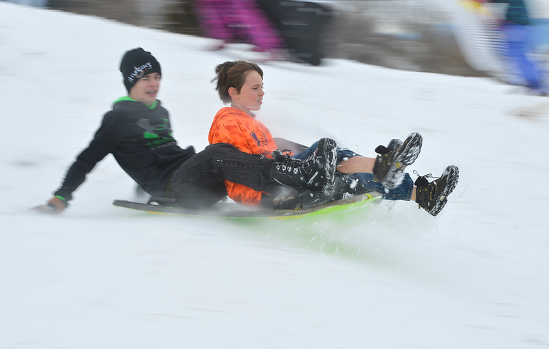 Justin Sheely | The Sheridan Press<br /> Fourteen-year-old Damian Roberts, left, and brother Teddy Roberts, 10, zip over the snow on Linden Hill Wednesday, Jan. 3, 2017.