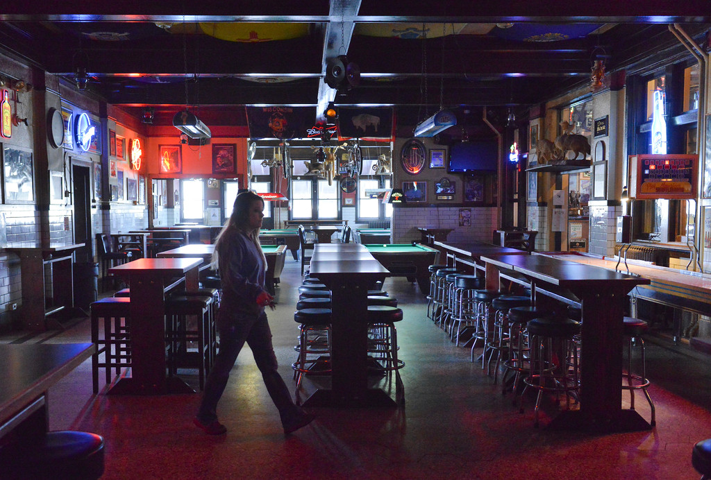 Justin Sheely | The Sheridan Press<br /> <br /> A server walks across the dance floor at Rails Brews and Cues Tuesday, Jan. 23, 2018. Business owners Art Erickson and Linda Erickson will sell Rails Brews and Cues in March of 2018. The building was established in 1912.
