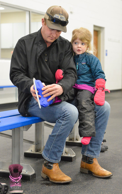 Justin Sheely | The Sheridan Press<br /> Kevin Dow puts skates on Eleanor Dow, 3, during ice skating lessons at Whitney Ice at the M&M's Center Tuesday, Jan. 16, 2018.