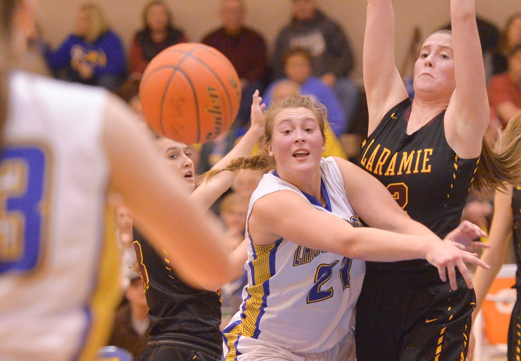 Justin Sheely | The Sheridan Press<br /> <br /> Sheridan's Jordan Christensen passes the ball against Laramie High School during their first conference game at Sheridan High School Friday, Jan. 19, 2018. The Lady Broncs won 57-40.