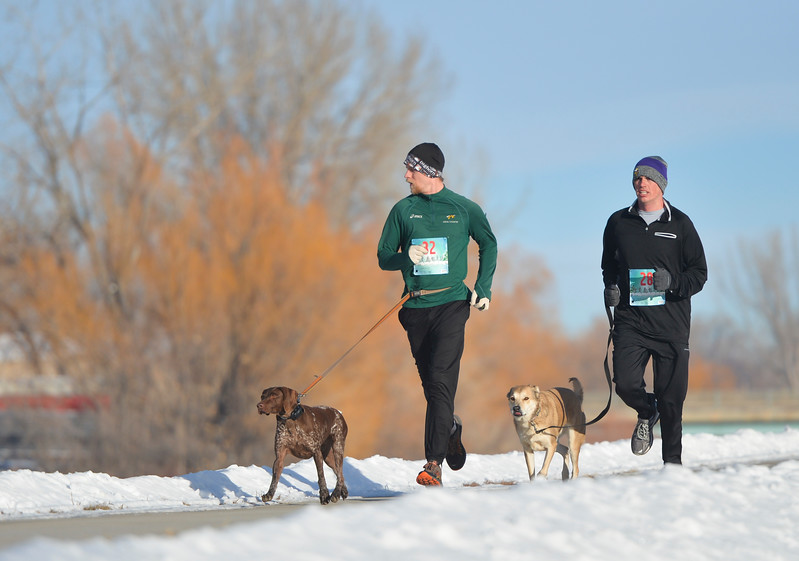 Justin Sheely | The Sheridan Press<br /> Laine Parish, left, and Birch Haradan run during the Sheridan Recreation District's second-annual Resolution Run 5k at Thorne-Rider Park Saturday, Jan. 6, 2018.