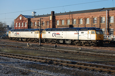 The early-morning sun illuminates former Cotswold Rail pair 47828 'Joe Strummer' and 47813, which have been resident in Doncaster West Yard for several months now (20/02/2010)