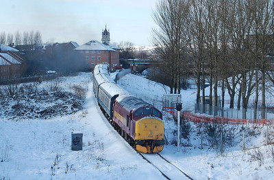 37418 (which was being used to heat one of the trains) brings up the rear of 2J65 as the '40' climbs over the 'ski jump' into Bury Bolton Street (09/01/2010)