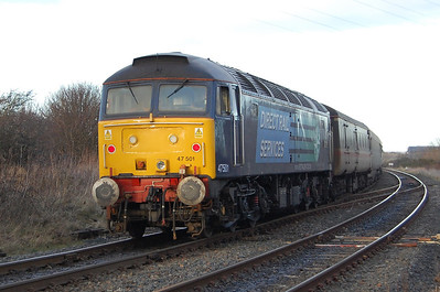 47501 glistens in the afternoon sun on the rear of 2T32 as the '57' departs Workington for the short run along the coast to Maryport (18/01/2010)