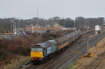 With the mist having cleared, 47501 is seen arriving at Maryport on the rear of 2T30 1335 ex-Workington, hauled by 57008 (18/01/2010)