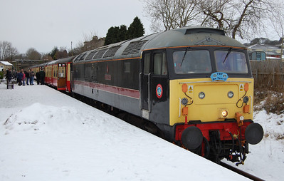 With a good covering of snow on the platform, 47715 waits at Leyburn with the 1355 to Leeming Bar (02/01/2010)