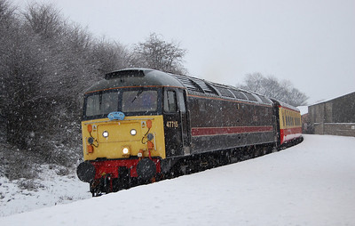 Having popped down the road for a quick pint in front of a warm fire in one of the local pubs, we walked back up to Bedale station in what could only be described as a blizzard. 47715 arrives with the the last train of the day from Leeming, the 1445 to Redmire (02/01/2010)