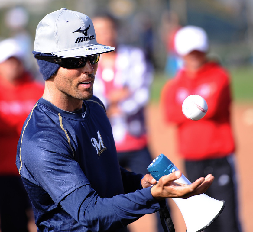 . Milwaukee Brewers scout Nate Trotsky led the workout session, using a baseball to keep the players focused each time he tossed the ball. Photo by Brad Graverson/ The Daily Breeze 3-27-14