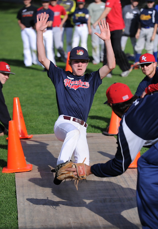 . Chase Meidroth works on sliding drills during practice with Japanese team before the weekend Little League tournament which will be held at Brett Field at Recreation Park, El Segundo. Photo by Brad Graverson 3-26-14