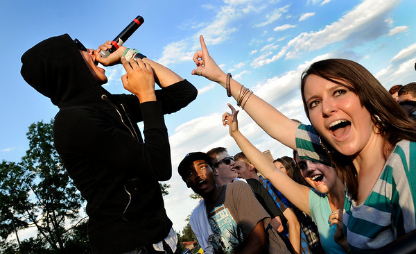 University of Colorado freshman Julian Thomas, left, sings for the crowd while sophomore Kevin Patterson, junior Bethany Marlatt and senior Lily Minkov, right, jam out during the Welcome Back Concert for the University of Colorado on Saturday, Aug. 21, at Farrand Field on the CU campus. Thomas was performing with Air Dubai which was last years winner of the CU Battle Of The Bands.<br /> Jeremy Papasso/ Camera