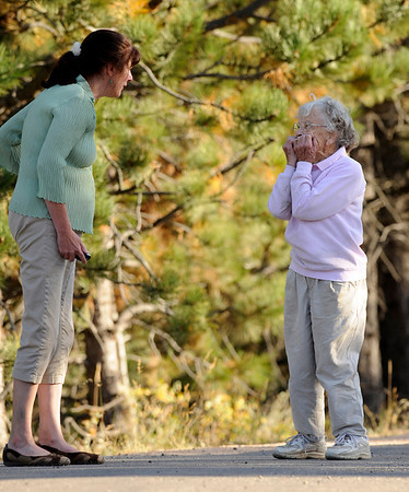 """Kathy Mantione, left talks with Elinor Winchester as they are evacuated during the Peewink Fire on Friday west of Boulder, Colorado on September 17, 2010. SEE MORE PHOTOS AND A VIDEO OF THE FIRE AT  <a href=""""http://WWW.DAILYCAMERA.COM"""">http://WWW.DAILYCAMERA.COM</a><br /> Photo by JEREMY PAPASSO"""