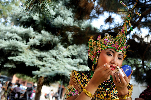 """Kadek Yuni, 21, of Colorado Springs, applies her makeup before performing on Saturday, Aug. 14, during the 16th Annual Boulder Asian Festival on Pearl Street in Boulder. Yuni was performing with Arcinda Indonesian Music and Dance.<br /> Jeremy Papasso/ Camera<br /> <br /> For video go to  <a href=""""http://www.dailycamera.com"""">http://www.dailycamera.com</a>"""