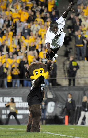 """University of Colorado mascot """"Chip"""" points to CU sophomore Ozell Williams after one of his high flying routines during the football game against Baylor on Saturday, Oct. 16, at Folsom Field in Boulder. Baylor defeated CU 31-25.<br /> For more photos go to  <a href=""""http://www.dailycamera.com"""">http://www.dailycamera.com</a><br /> Photo by Jeremy Papasso/ Camera"""
