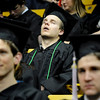 University of Colorado graduate Zach Carter takes a nap on Friday, Dec. 17, during the University of Colorado Fall Commencement Ceremony at the Coors Events Center on the CU campus in Boulder.<br /> Jeremy Papasso/Camera