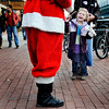 "Katja Rodd, 4, of Boulder, smiles after receiving a candy cane from Santa Claus Pete Dinstuhl, 64, of Boulder on Friday, Dec. 24, on the Pearl Street Mall. For a video of Santa Pete on Pearl Street go to  <a href=""http://www.dailycamera.com"">http://www.dailycamera.com</a><br /> Jeremy Papasso/Camera"