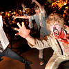"Pierre Bouchard, right, and Jenna Noah, both of Boulder, act as a zombie while performing during Michael Jackson's ""Thriller"" on the Pearl Street Mall on Saturday, Oct. 30.<br /> For more photos and video go to  <a href=""http://www.dailycamera.com"">http://www.dailycamera.com</a><br /> Jeremy Papasso"