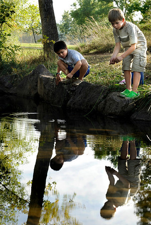 "Miguel Gallegos, 7, left, and his friend Ian Hagen, 7, both of Boulder, fish for crawfish in a section of the Boulder Creek near Martin Park on Friday, Sept. 24. The area is part of Martin Acres, which was a post WWII subdivision.<br /> For a video on Martin Acres go to  <a href=""http://www.dailycamera.com"">http://www.dailycamera.com</a><br /> Jeremy Papasso/ Camera"