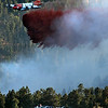 "A slurry bomber drops retardant just above a checkpoint where people can be seen with there cars during the Peewink Fire on Friday west of Boulder, Colorado on September 17, 2010. SEE MORE PHOTOS AND A VIDEO OF THE FIRE AT  <a href=""http://WWW.DAILYCAMERA.COM"">http://WWW.DAILYCAMERA.COM</a><br /> Photo by JEREMY PAPASSO"