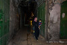 Woman-heading-home-after-market-closes,-Jerusalem