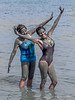 A happy pair of women cover themselves in 'beauty' mud from the Dead Sea in Israel.