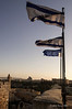 Israeli-flags-near-sunset,-top-of-Citadel,-Jerusalem