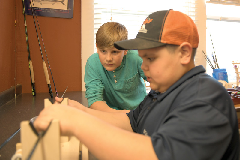 Matthew Gaston | The Sheridan Press<br>Ryder Dilloway, left, and his cousin Anthony Kindle do everything together from building fly rods, to fishing, to just horsing around at Joey's Fly Fishing Foundation Thursday, April 11, 2019.