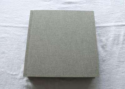This is a new linen available (as an upgrade from the standard covers) called Storm which is a dark grey and white mix (seen better in some of the other photos).  Inside the album the pages are black