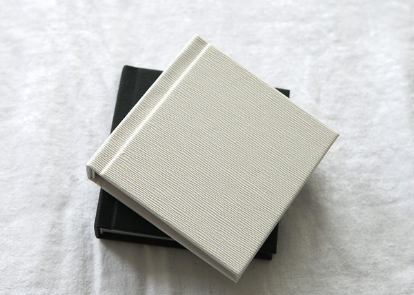 Here's two of the 3 and a half inch square albums - they each have 10pages/20sides and can hold up to 40 of your favourite images